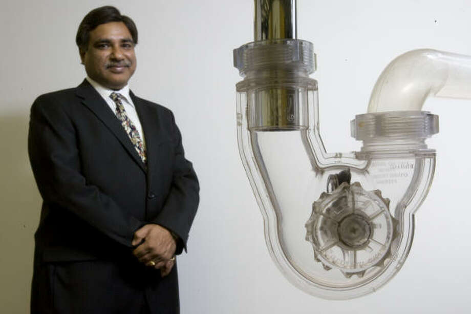 Sanjay Ahuja, vice president of PF WaterWorks,  says his company aims to eliminate the need for harsh chemical drain cleaners and to reduce gray water pollution Photo: MELISSA PHILLIP:, CHRONICLE