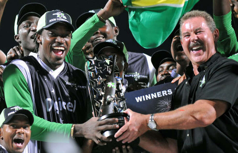 Sir R. Allen Stanford celebrates last year after the Stanford Superstars met England in the Stanford 20/20 Super Series at the Stanford Cricket Ground in St. John's. Stanford won. Photo: JEWEL SAMAD, AFP/Getty Images