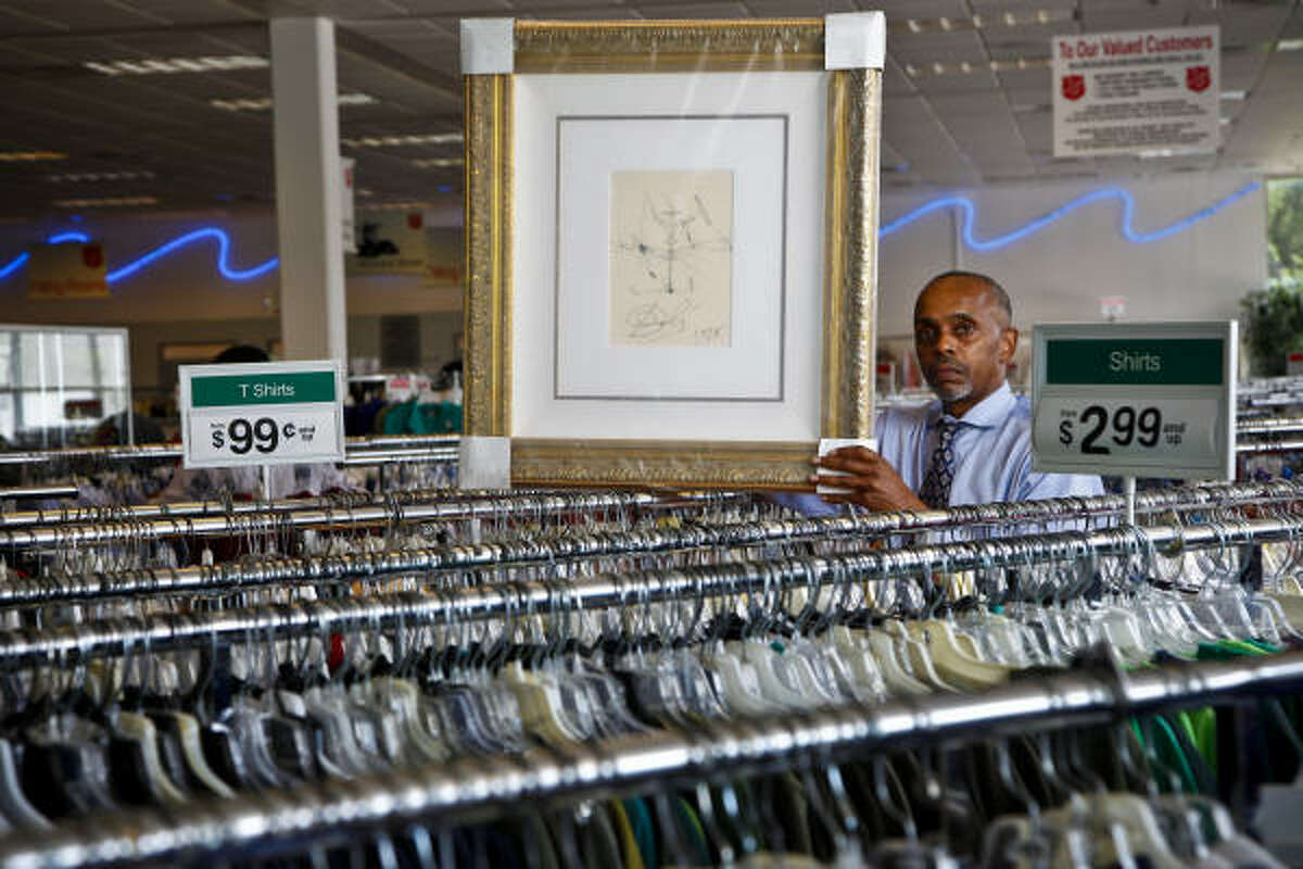 """Salvation Army assistant store manager Carl Roberts, with one of the authenticated Dalís, says this isn't the first Dalí item from the anonymous donor. The others were sold on eBay, but this time, """"we wanted to give our community here something ... to see."""""""