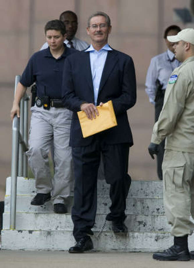 THEN: R. Allen Stanford, escorted by guards in June, is accused of a $7 billion fraud. He has been in solitary confinement some of the time since June. Photo: Johnny Hanson :, Chronicle