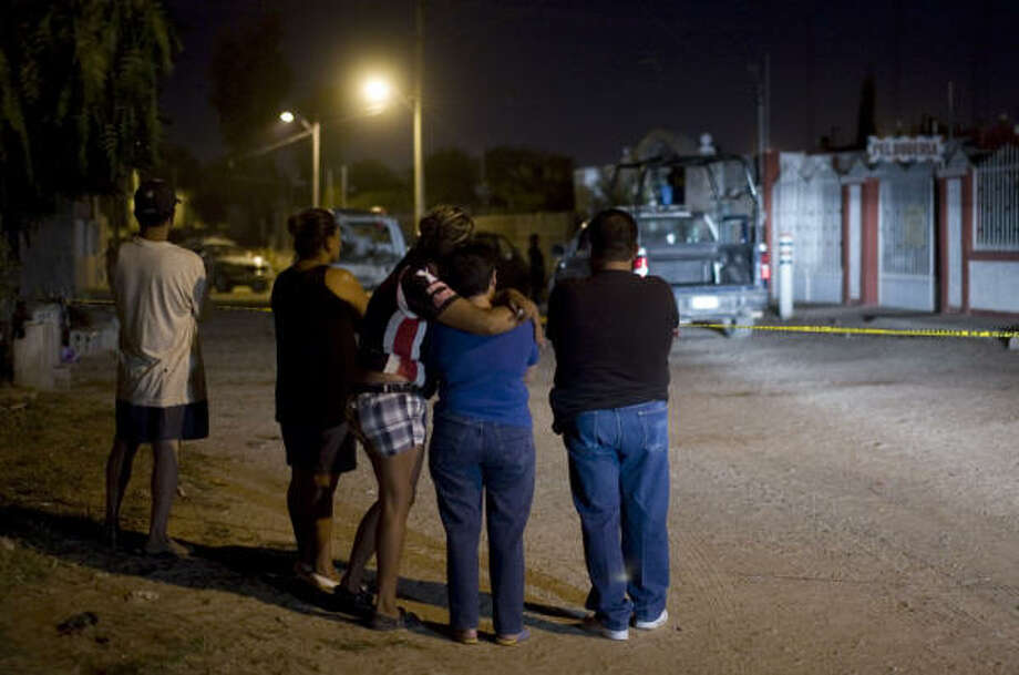 Relatives wait for news outside the drug rehab center in Ciudad Juarez where gunmen killed two doctors and eight clients late Tuesday. A similar attack earlier this month killed 18. Photo: Guillermo Arias, AP