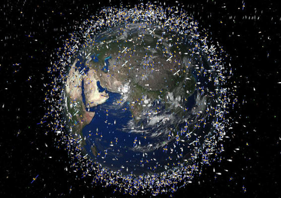 This computer-generated art from the European Space Agency approximates the 12,000 objects that are orbiting the earth. Photo: AFP/Getty Images