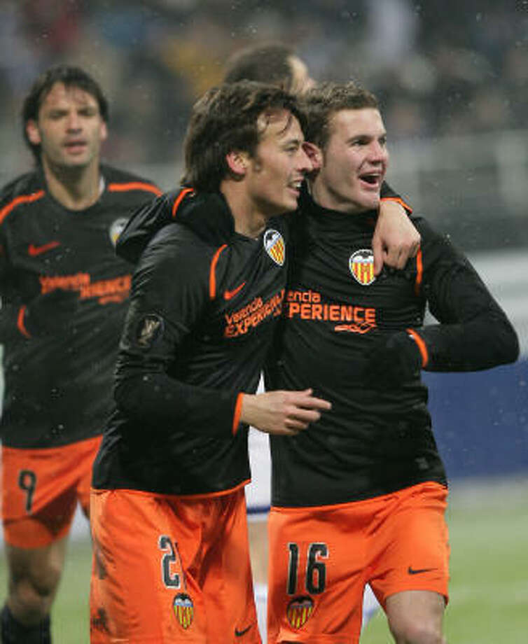 Valencia's David Silva, left, and Ruben Baraha celebrate after a goal during the  UEFA Cup. Photo: Andrei Lukatsky, AP
