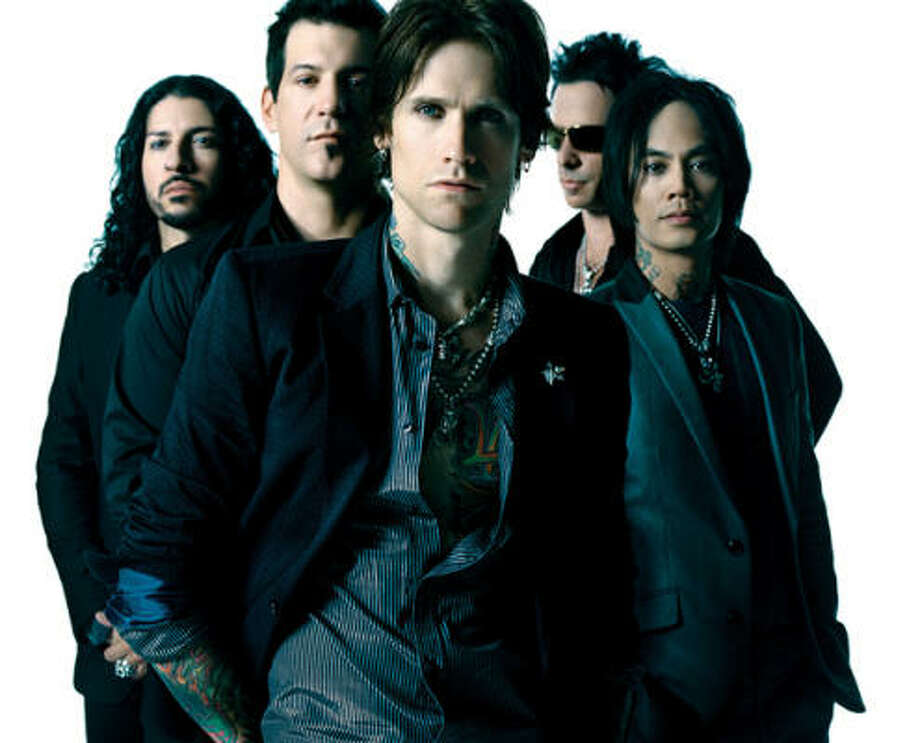 """Buckcherry lead singer Josh Todd, center, says he thinks the band is """"really hitting a stride."""" The band is currently on the road with Kiss. Photo: James Minchin"""