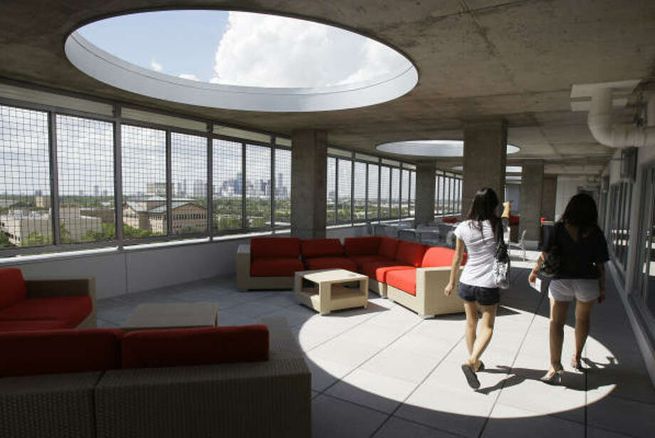 Yann-Bor Wen, left, and her roommate, Lina Xia, check out the terrace at Calhoun Lofts, the University of Houston's new residential hall. Photo: Melissa Phillip, Chronicle