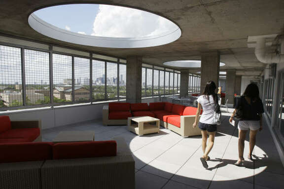 Yann-Bor Wen, left, and her roommate, Lina Xia, check out the terrace at Calhoun Lofts, the University of Houston's new residential hall.