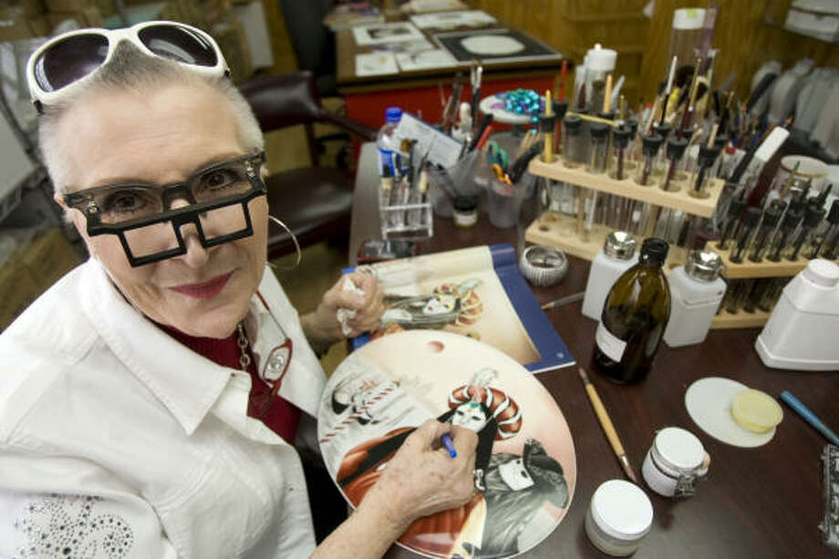 Cheri Holder finds solace in her studio, where she paints and sandblasts porcelain. Photo: Johnny Hanson, Chronicle