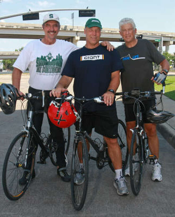 John Shinsky, from left, Joe DeLamielleure and Eljay Bowron are former college football teammates doing a 2,000-mile bicycle ride into Matamoros, Mexico, to raise money for an orphanage. Photo: Gary Fountain, For The Chronicle