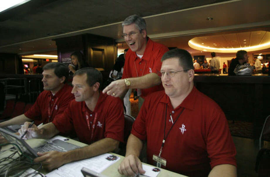 The Rockets stat crew, which includes Ken Nicholas (from left), Jim Mann, Trey Wilkinson and Tracy Clayton, impresses even numbers-crunching GM Daryl Morey. Photo: Karen Warren, Houston Chronicle