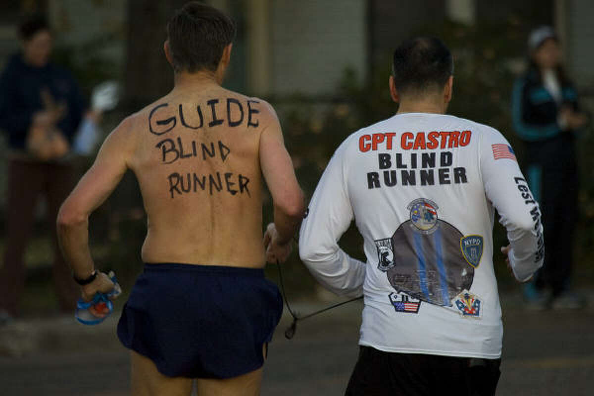 Ivan Castro, a visually impaired captain in the U.S. Army, has run five marathons, including the New York and Boston races.