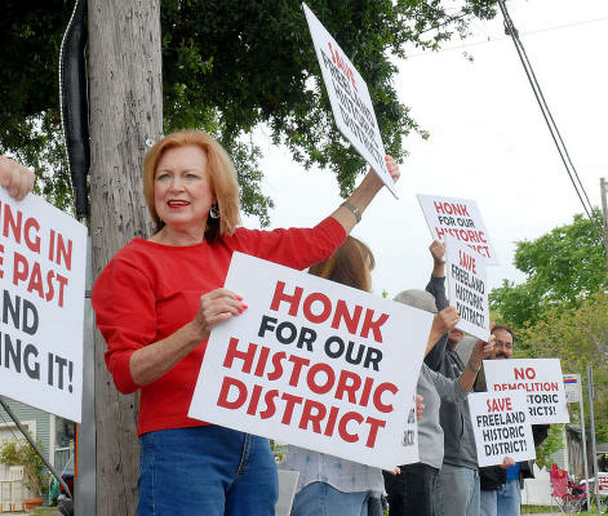 CONTINUING TO PROTEST: Jean Taylor and other residents protest on April 11 plans to raze a 1929 bungalow in the Freeland Historic District.