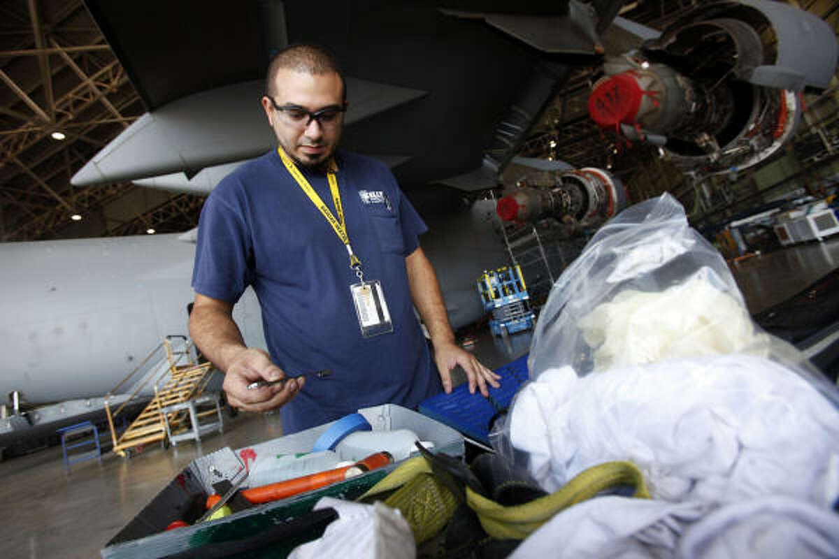 Aircraft mechanic Rob Guerra IV, who spent this past week working under the wing of an Air Force C-17, is one of more than 9,500 employees now at Boeing San Antonio.