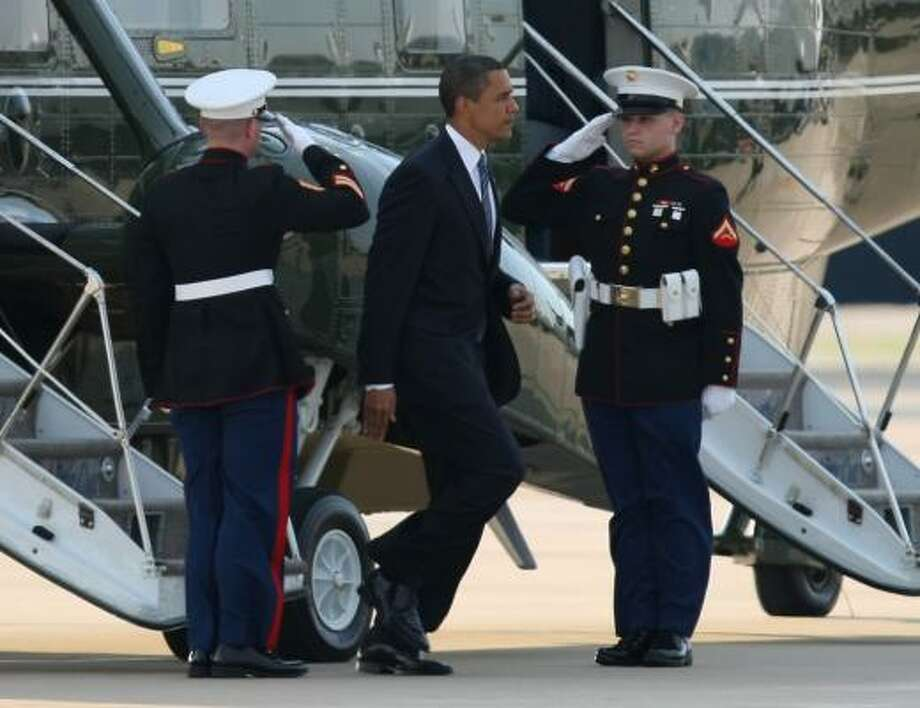 President Barack Obama steps off Marine One upon his arrival at Washington Dulles International Airport in Chantilly, Va., Tuesday, June 2, 2009, en route to the Mideast.  (AP Photo/Luis M. Alvarez) Photo: Luis Alvarez, AP