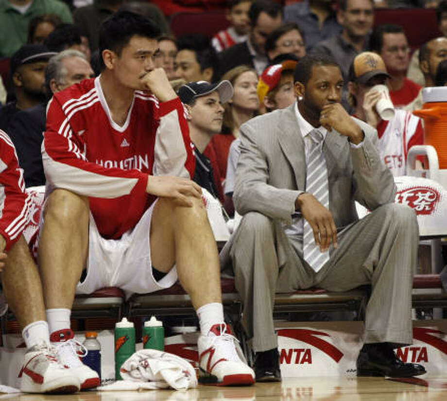 Yao Ming, left, and Tracy McGrady were supposed to lead the Rockets back to the NBA Finals. Photo: Brett Coomer, Houston Chronicle