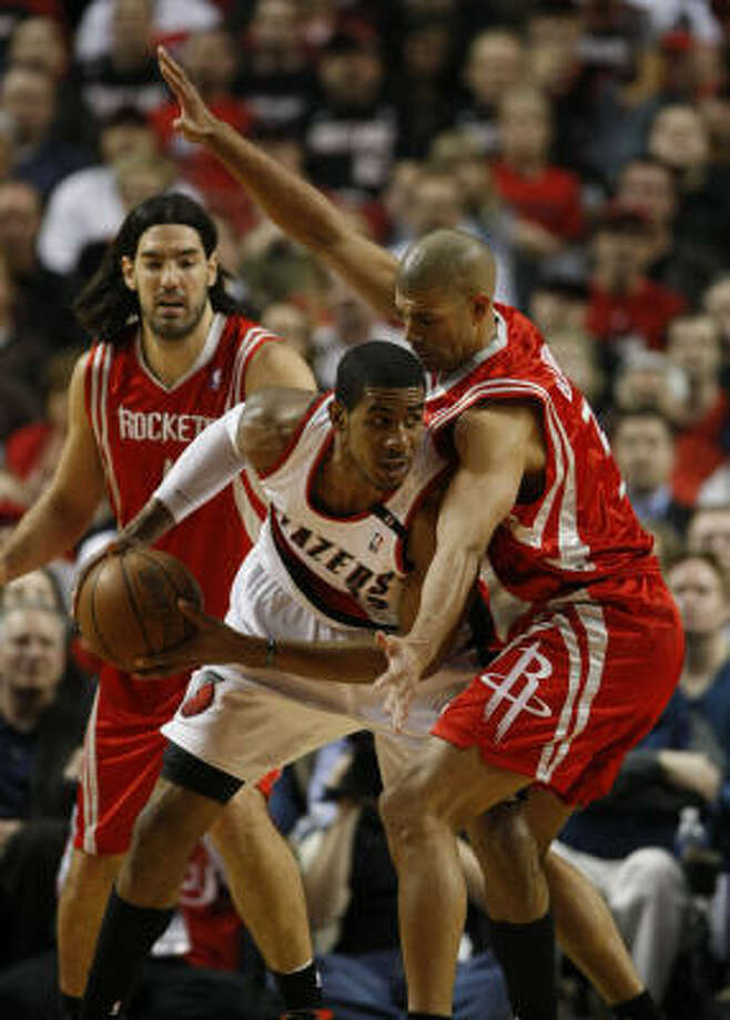 Trail Blazers forward LaMarcus Aldridge (12) is double teamed by Rockets forward Luis Scola (4), back and forward Shane Battier (31). Photo: Nick De La Torre, Chronicle