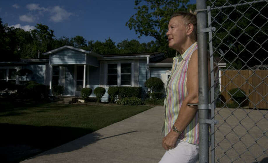 Gayle Seale has lived in the Glen Lee subdivision near Bush Intercontinental Airport for 25 years. She said if they're forced to sell their properties to make way for the airport, they won't have retirement money.  Photo: Billy Smith II