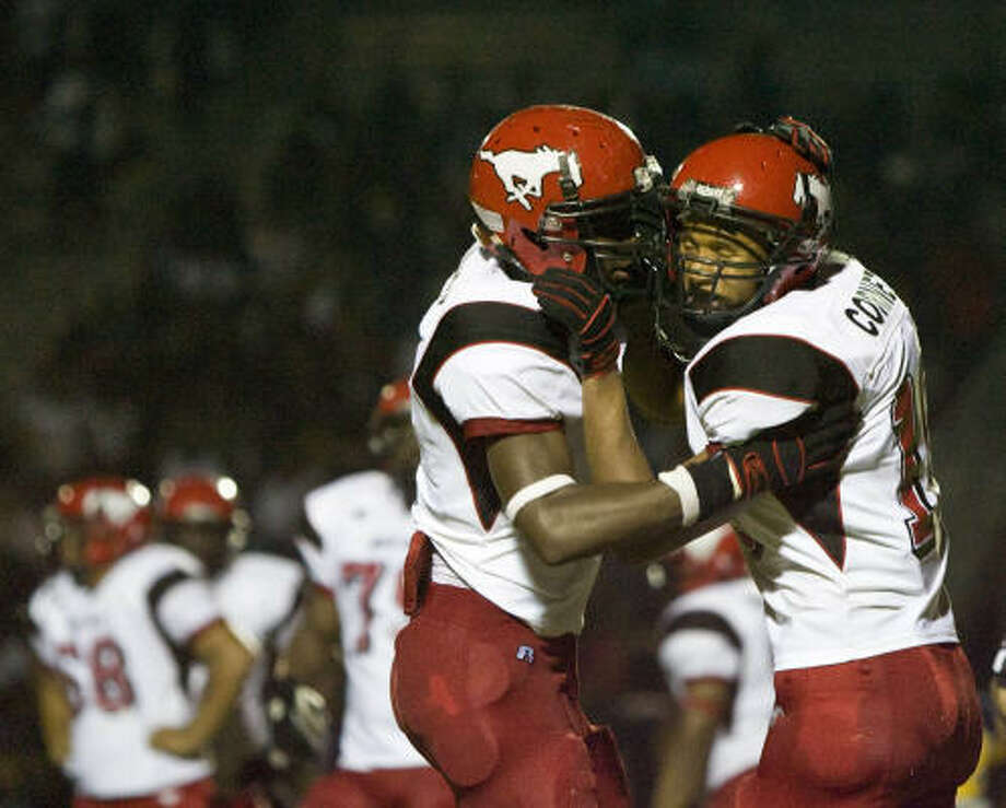 North Shore's Keenon Gibson, left, celebrates with teammate Tim Cornett after Cornett scored his third touchdown in the fourth quarter. Photo: Nick De La Torre, Chronicle