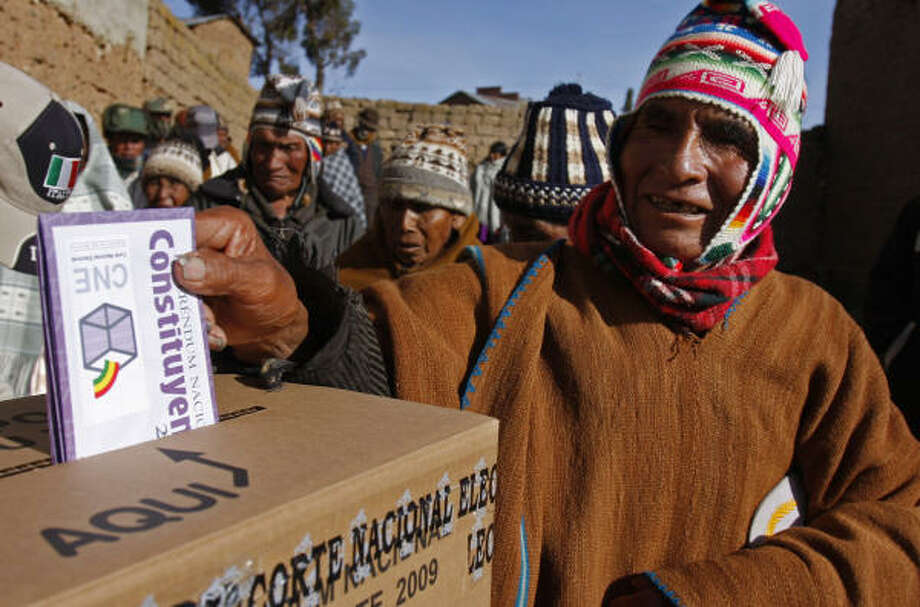 An Aymara Indian casts his ballot at a voting center in a rural school in Walata Chico, Bolivia, Sunday.  Bolivians are voting on President Evo Morales' proposed changes to the constitution, aimed at remaking the country on behalf its indigenous majority, Photo: Juan Karita, AP