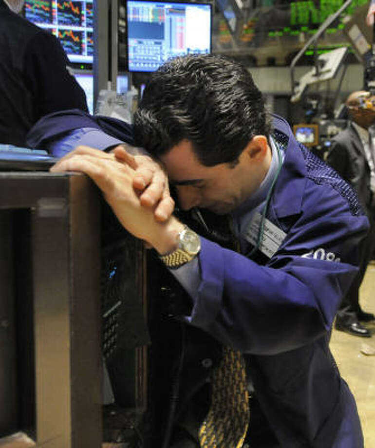 Specialist Peter Mazza works on the floor of the New York Stock Exchange on Monday. Photo: Richard Drew, Associated Press