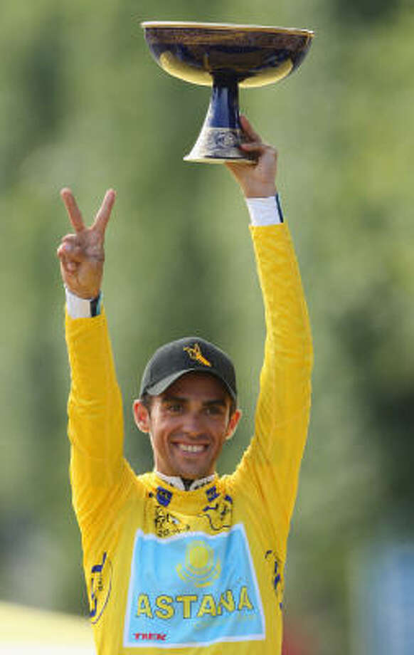 Yellow Jersey holder and race winner Alberto Contador of Spain and Astana holds aloft the trophy after Stage 21 of the Tour de France on Sunday. Photo: Bryn Lennon, Getty Images