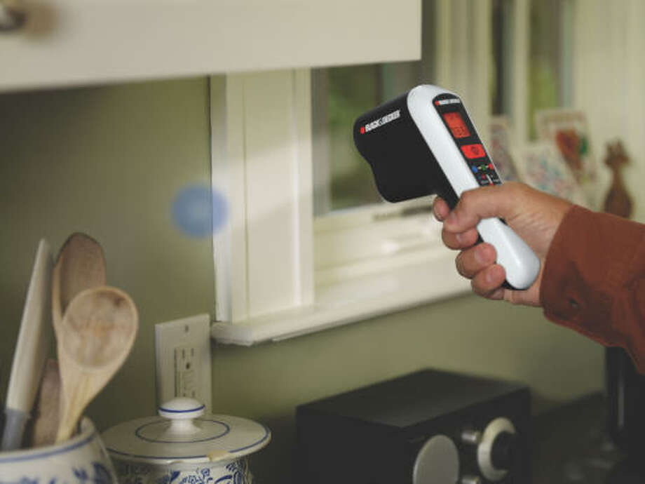 INFRARED READER: The laser beam from the Thermal Leak Detector turns blue when it senses a cooler spot and red for warmer spots.