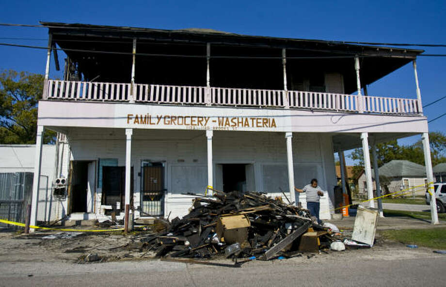 The second floor of Family Grocery-Washateria in the 1100 block of  Brooks at Common in north Houston, where three people died Sunday, is a burned-out shell. Photo: Karen Warren, Chronicle
