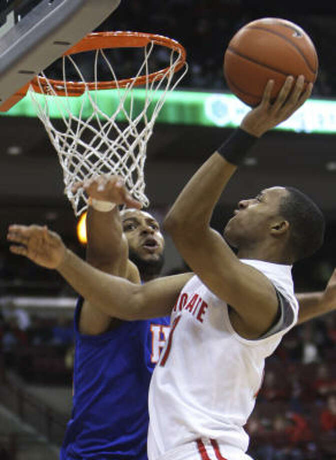 Ohio State's Evan Turner shoots over Houston Baptist's Emanuel Willis during the second half. Photo: Jay LaPrete, AP