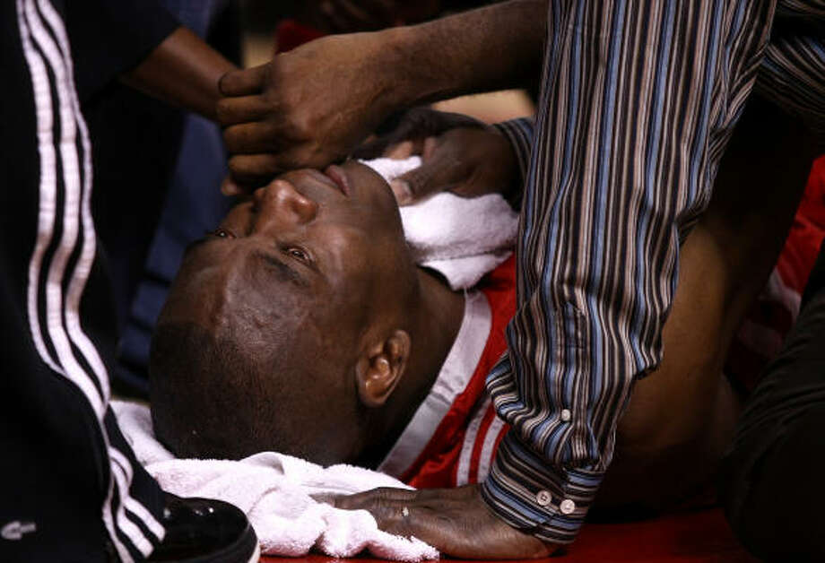 Dikembe Mutombo lies in pain after an injury against the Portland Trail Blazers during Game 2 of the Western Conference Quarterfinals of the NBA Playoffs. Photo: Jonathan Ferrey, Getty Images