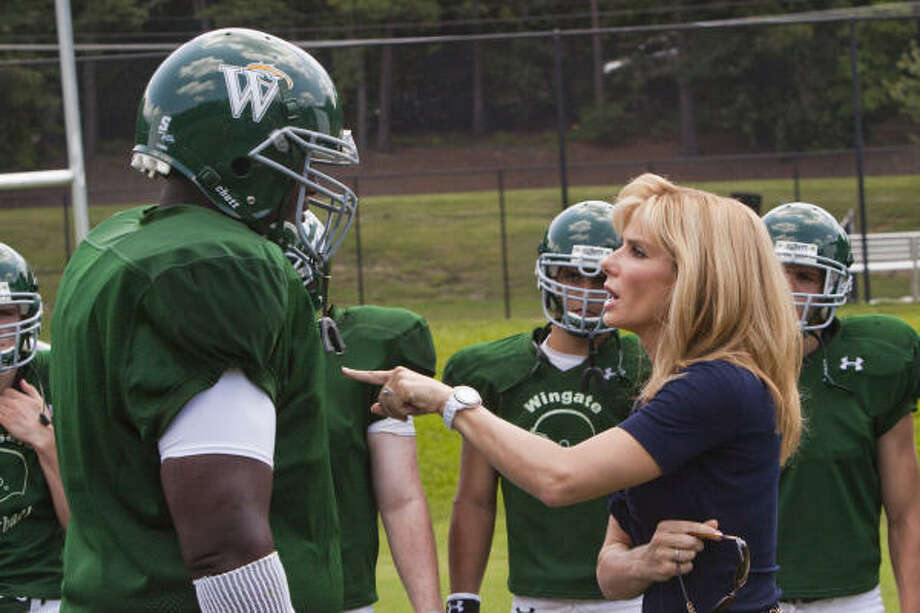 A rich housewife (Sandra Bullock) steers a homeless teen (Quinton Aaron) in the right direction. Photo: WARNER BROS.