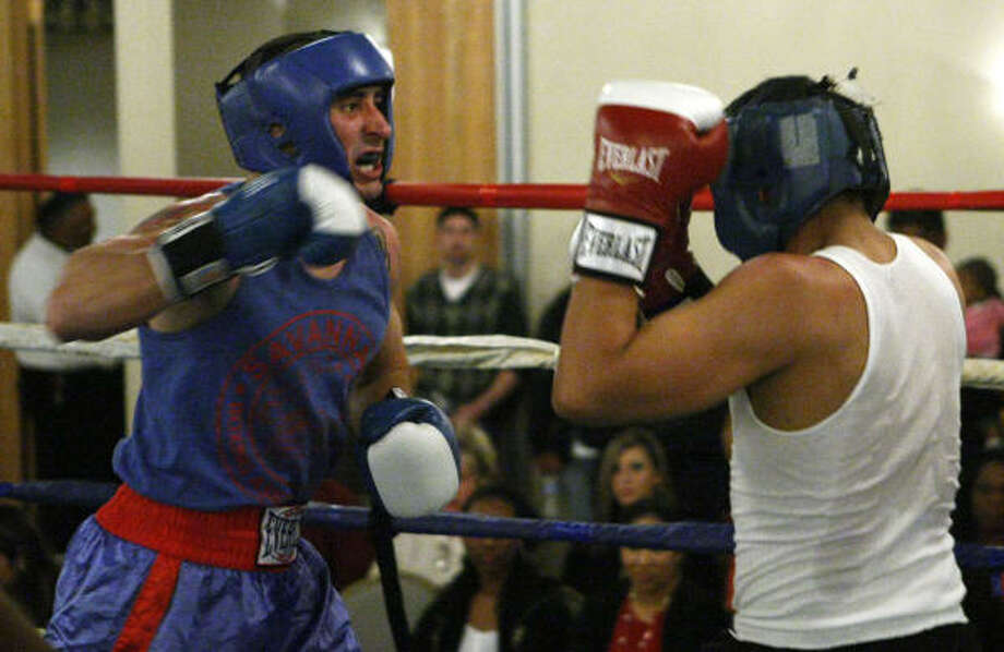 Kelly Barnett, left, of Savannah Boxing Gym, won by decision in his bout against Elmer Gomez of Main Gym during the Golden Gloves tournament Thursday. Photo: Brett Coomer, Chronicle
