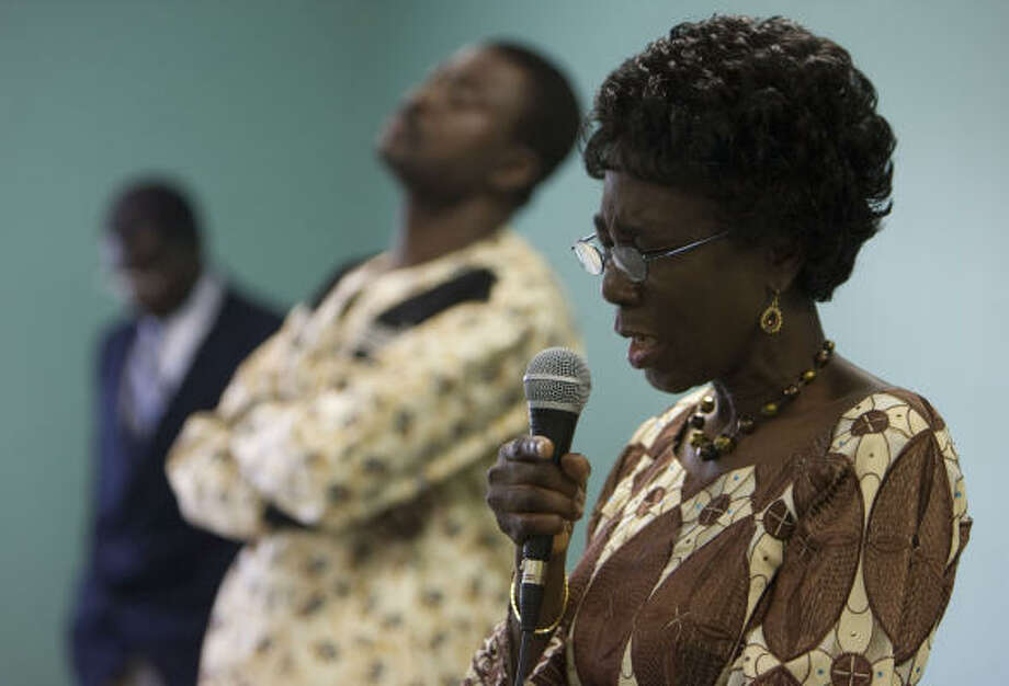 Ghana native Elizabeth Anane-Sekyere, shown at a church service, says there are certain expectations when you move to the U.S. Photo: Sharon Steinmann, Chronicle