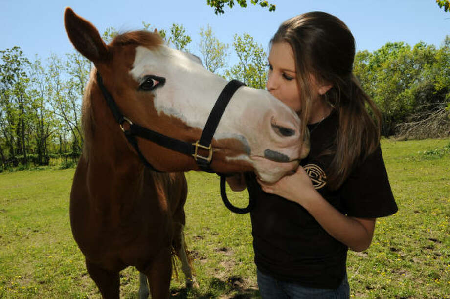 GIRL'S BEST FRIEND: Heather White poses with her horse Misty at her barn in Dickinson. Photo: Kim Christensen, For The Chronicle