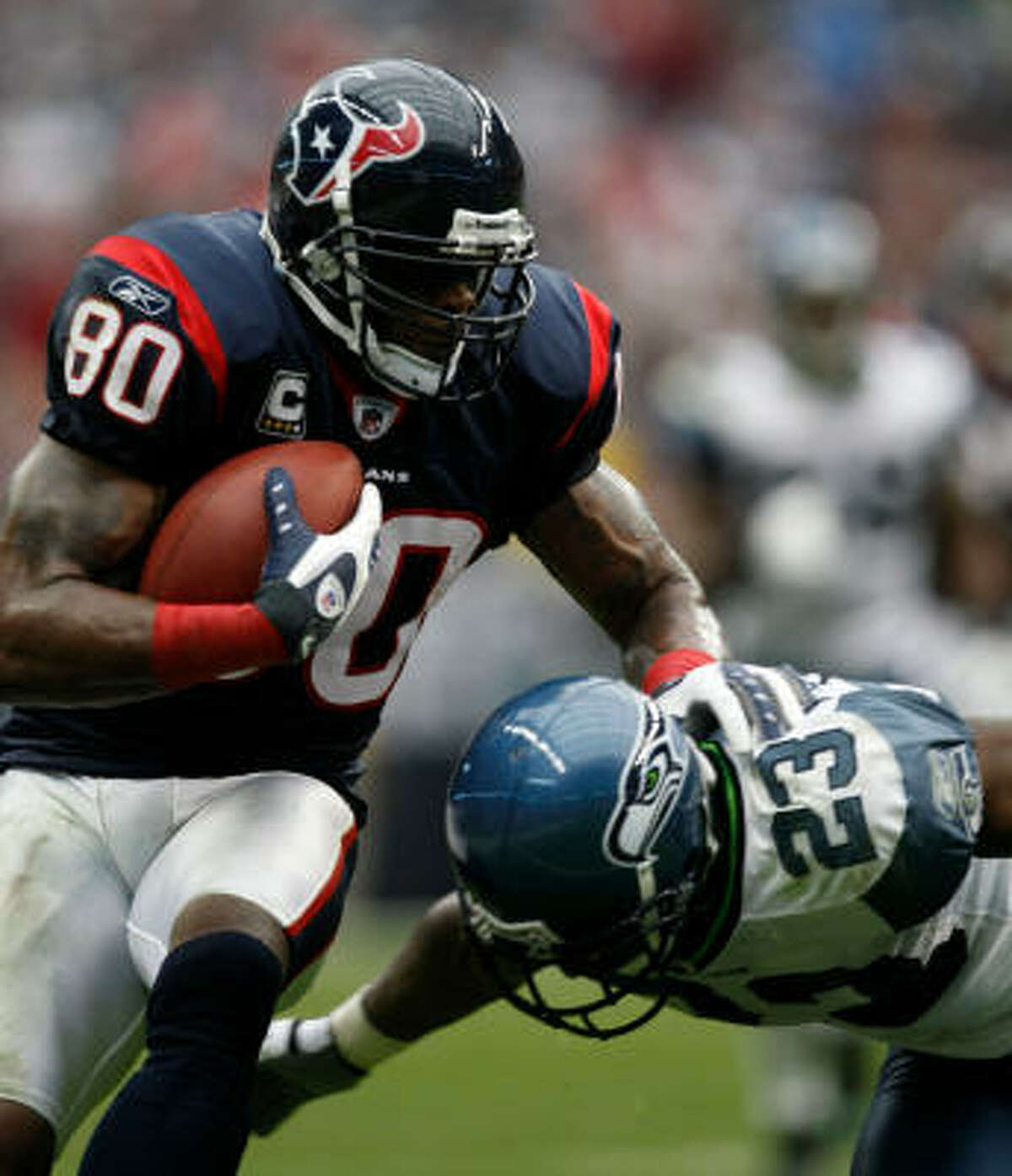 As Seattle's Marcus Trufant (23) learned, Andre Johnson was an irresistible force for the Texans on Sunday.