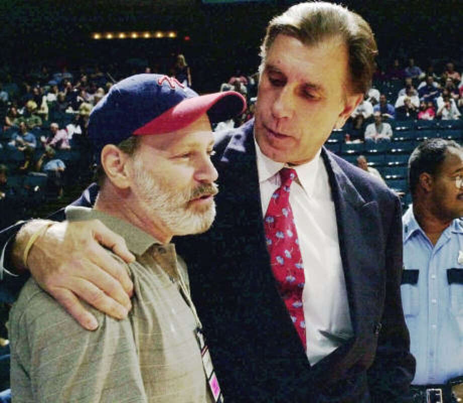 Long-time Houston photographer Tim Johnson is shown with former Houston Rockets coach Rudy Tomjanovich. Johnson died July 7. Photo: Tim Johnson Family