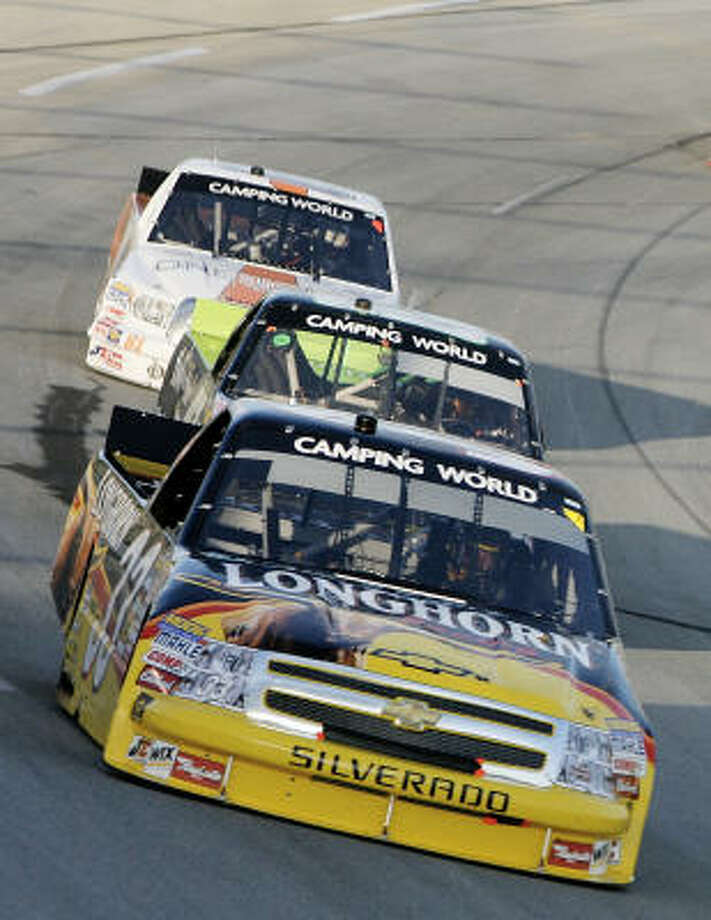 Ron Hornaday Jr., front, became the first driver to win the Built Ford Tough 225 twice in the race's 10-year history. Photo: John Sommers II, Getty Images
