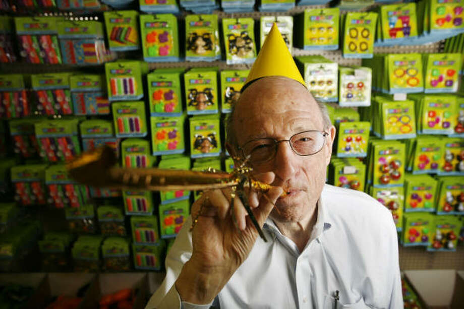 """While his store was closed for repairs, 83-year-old Arne's owner Arnold Grossman """"took off a few days."""" But mostly he worked, doing such tasks as rearranging his filing system. rnold Grossman, owner of Arnie's Warehouse & Party Store. It's just reopened after being closed for 11 months from Hurricane Ike damage. Photo: Eric Kayne, For The Chronicle"""