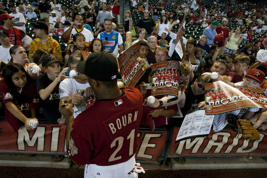 Astros outfielder Michael Bourn signs autographs before the final home game of the season. Photo: Smiley N. Pool, Houston Chronicle