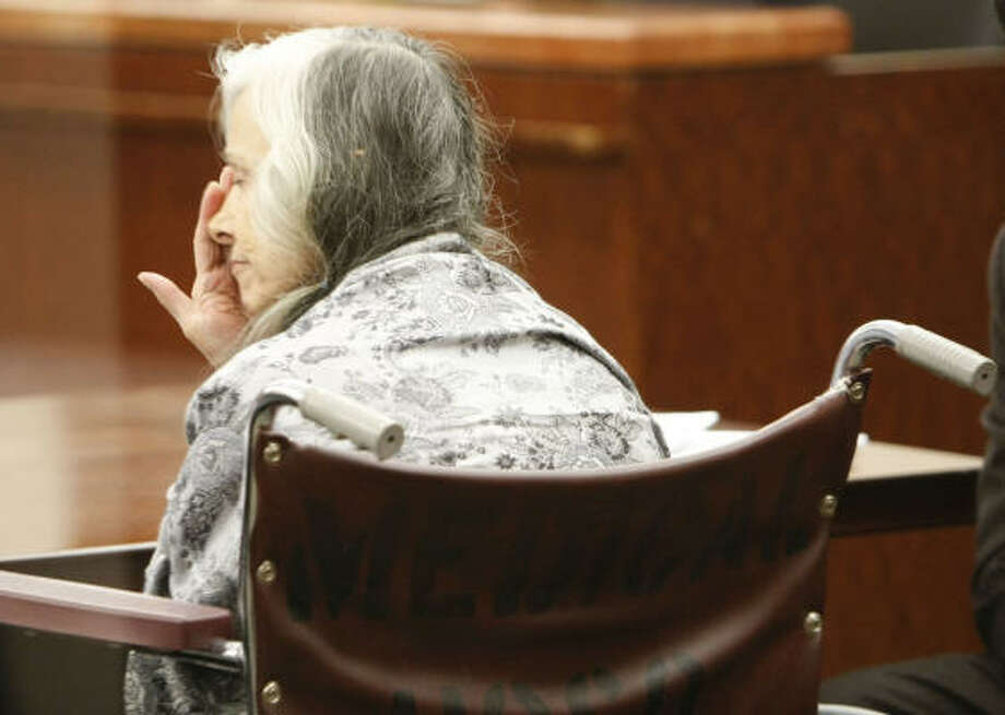 Najia Omar Mohamad, an Afghan refugee, sat in a wheelchair as her trial got under way in a Houston court on Tuesday. Photo: Julio Cortez, Chronicle