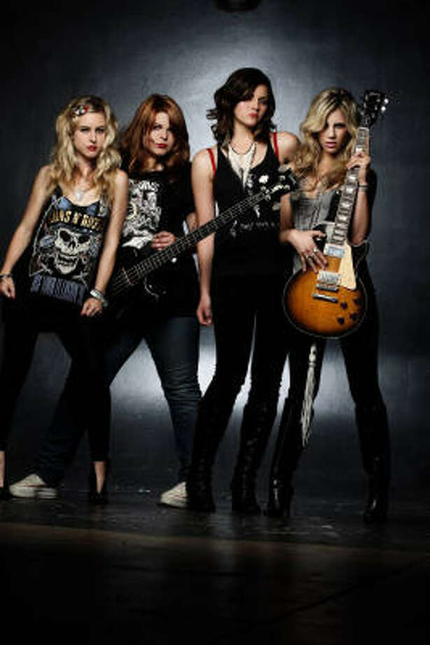 The Donnas take the stage for a show Sunday night at the Arena Theater. Photo: Neil  Zlozower