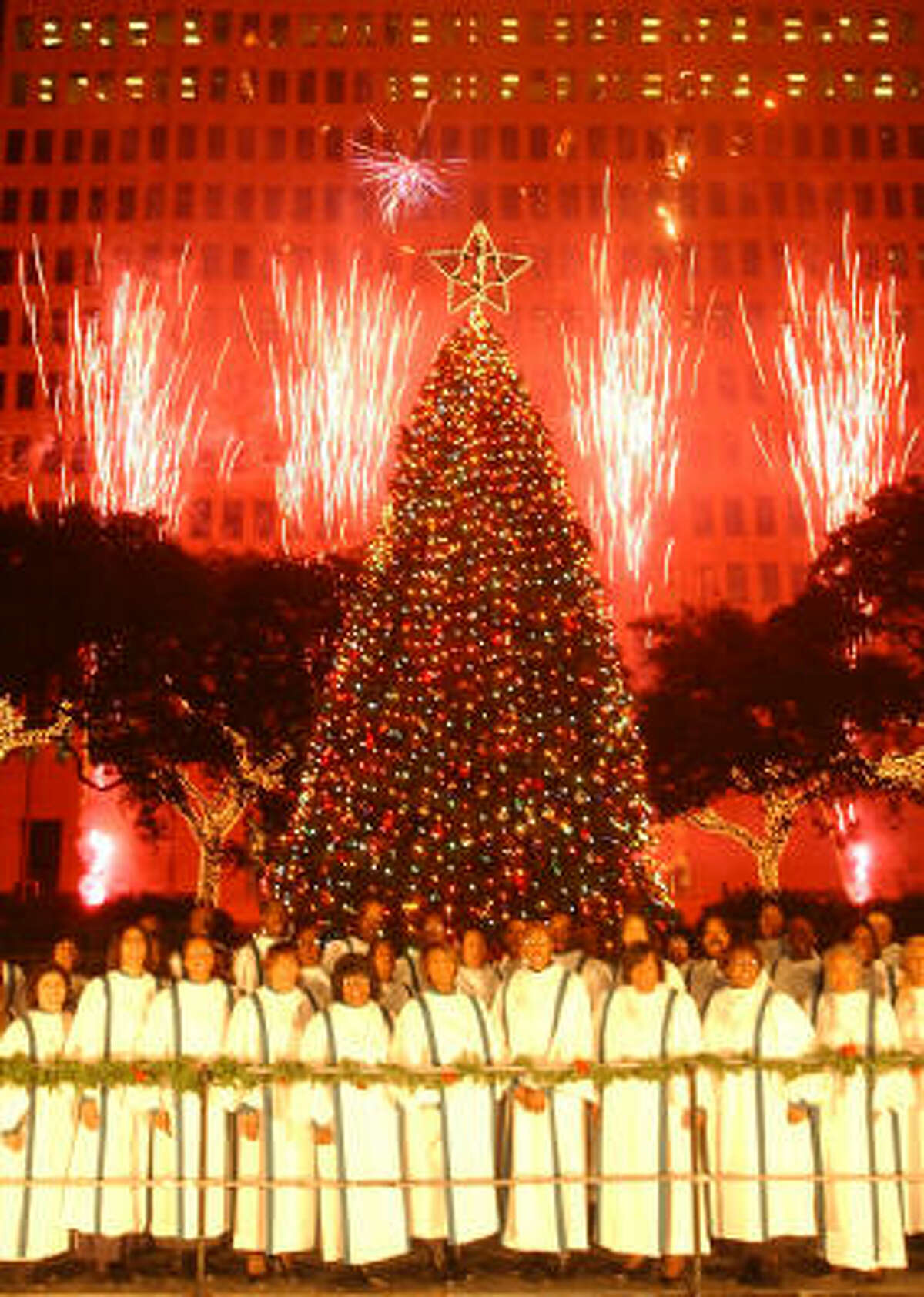 Members of the Mount Corinth Missionary Baptist Church performed the Hallelujah chorus as fireworks illuminated downtown during Mayor Lee P. Brown's Houston Holiday Celebration at City Hall in 2002.