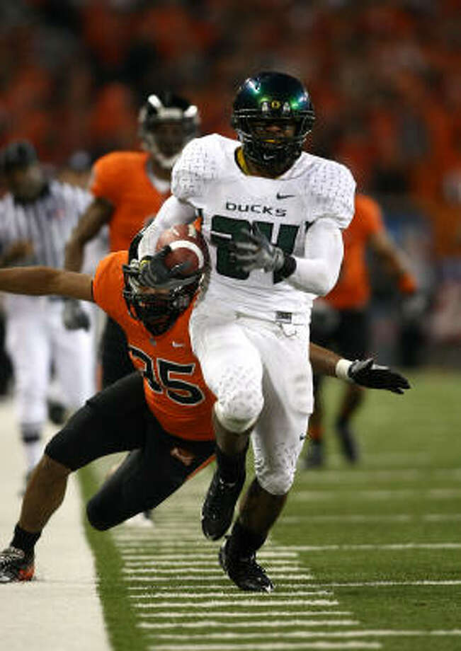 Jeremiah Johnson has big-play ability, like this 83-yard run he broke for Oregon against Oregon State last season. Photo: Jonathan Ferrey, Getty Images