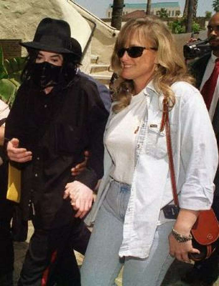 TMZ.com is alleging the two children Michael Jackson's ex-wife Debbie Rowe gave birth to were conceived using anonymous donated sperm and eggs. Photo: Associated Press