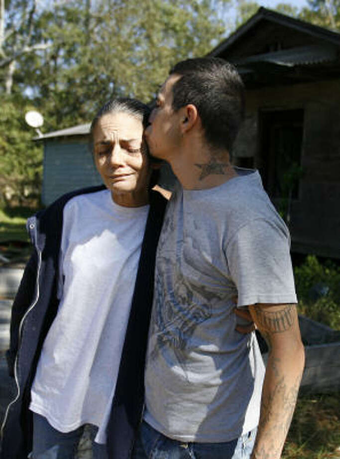 Sharon Clark and her son, Milton Torres, are mourning Clark's daughter and granddaughter, two of the four who died Saturday. Photo: Karen Warren, Chronicle