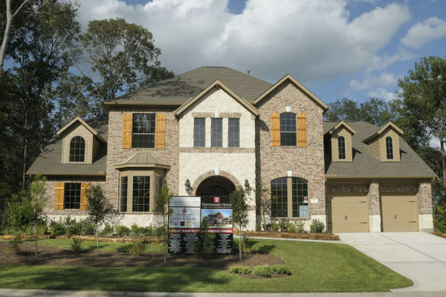 FALL FUN: May Valley Park in The Woodlands' Village of Sterling Ridge will be the setting for the Turkey Trot. Visitors can tour the GHBA Benefit home (shown).