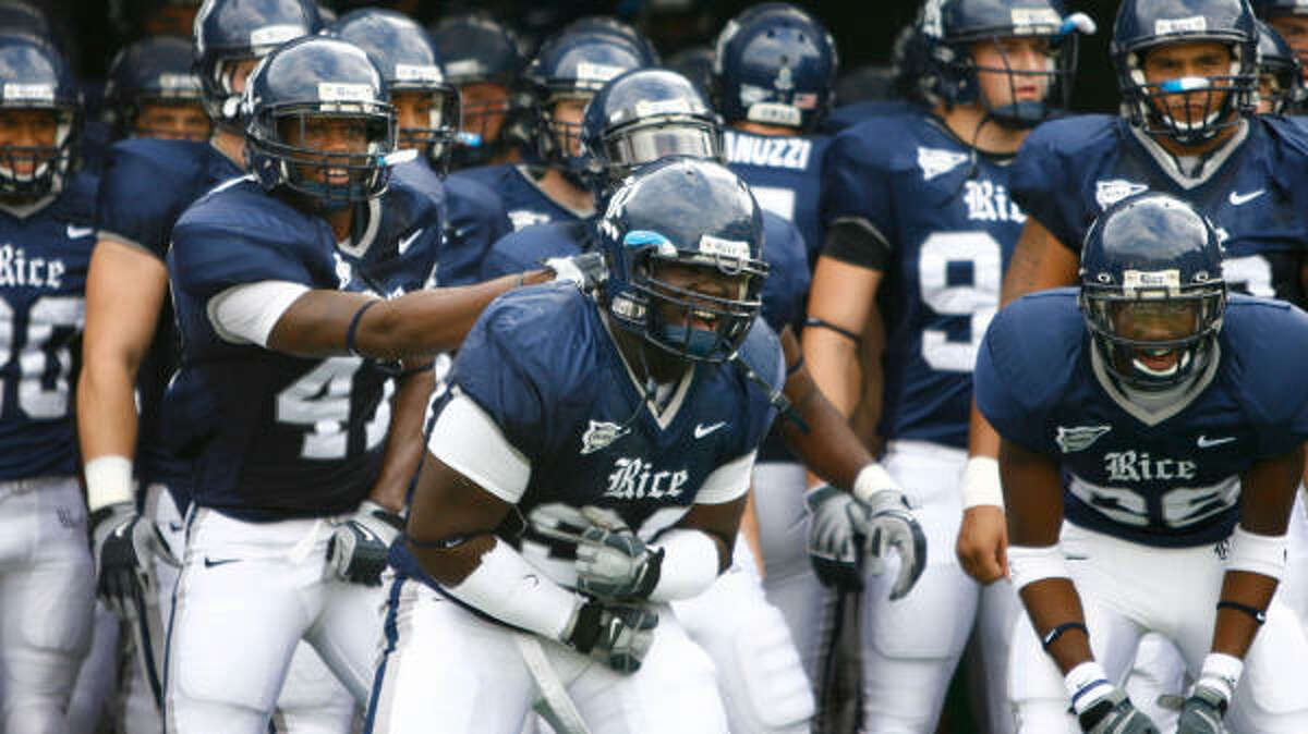 Rice defensive tackle Michael Smith (99) and his teammates get riled up before taking the field before Saturday's game against Tulane.