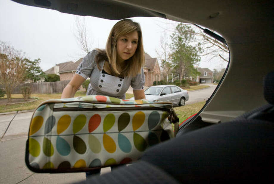 JOBS: Nicole Gelsomini loads her car for her trip back to Austin from The Woodlands. She's looking for a job but so far she hasn't received a single offer despite her straight-A average. Photo: Steve Campbell, Houston Chronicle