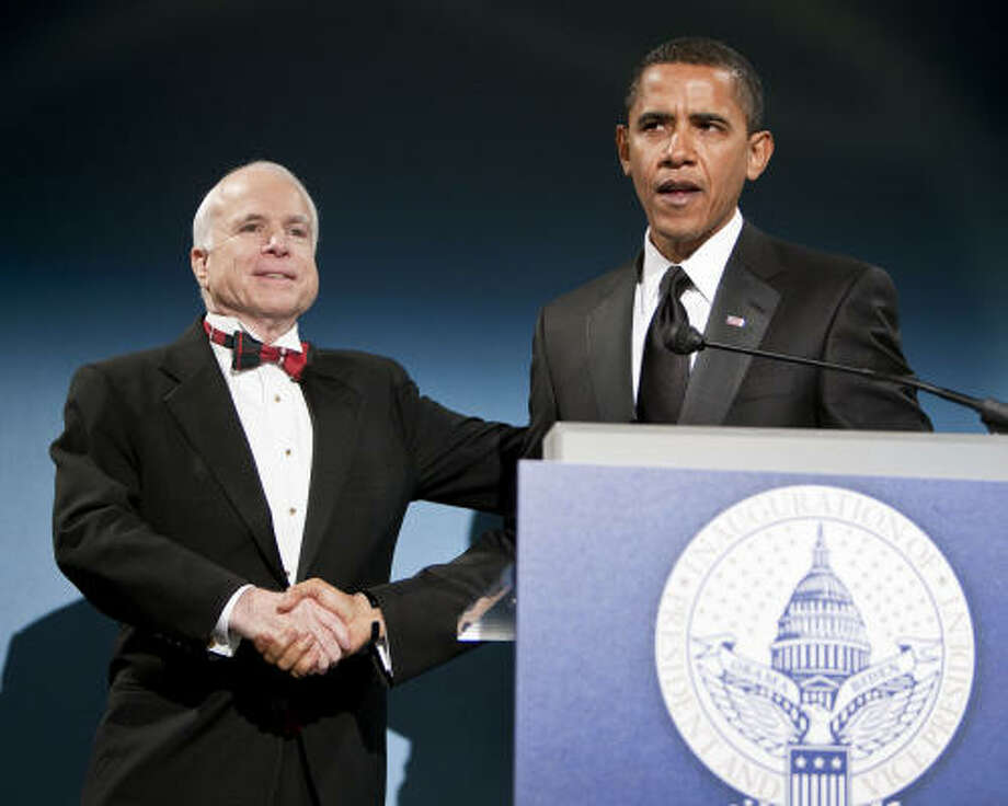Barack Obama introduces his former political rival, Sen. John McCain, at a bipartisan dinner Monday evening honoring the Arizona Republican at the National Building Museum in Washington, D.C. Photo: JOSHUA ROBERTS, Getty Images
