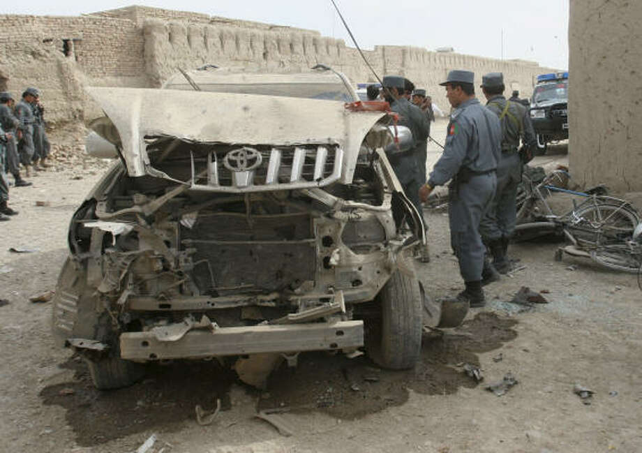 A damaged vehicle is seen at the site of a blast in Kandahar province south of Kabul, Afghanistan, on Sunday. Photo: Allauddin Khan, AP