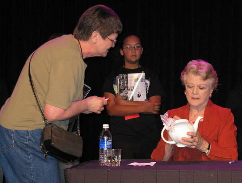 Memorial Parkway Junior High theater arts teacher Catherine Huvar asked actress Angela Lansbury to autograph a teapot at a recent teachers' convention. Photo: Courtesy, Memorial Parkway Junior High