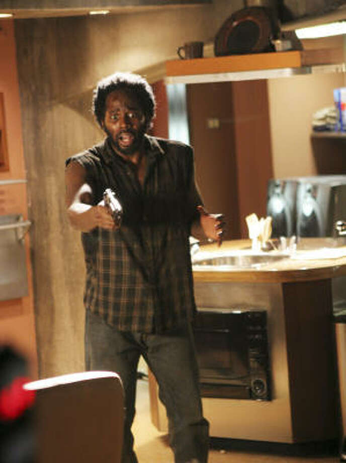 "Michael (Harold Perrineau) shoots two castaways in the Season 2 episode ""Two for the Road."" Photo: MARIO PEREZ, ABC"